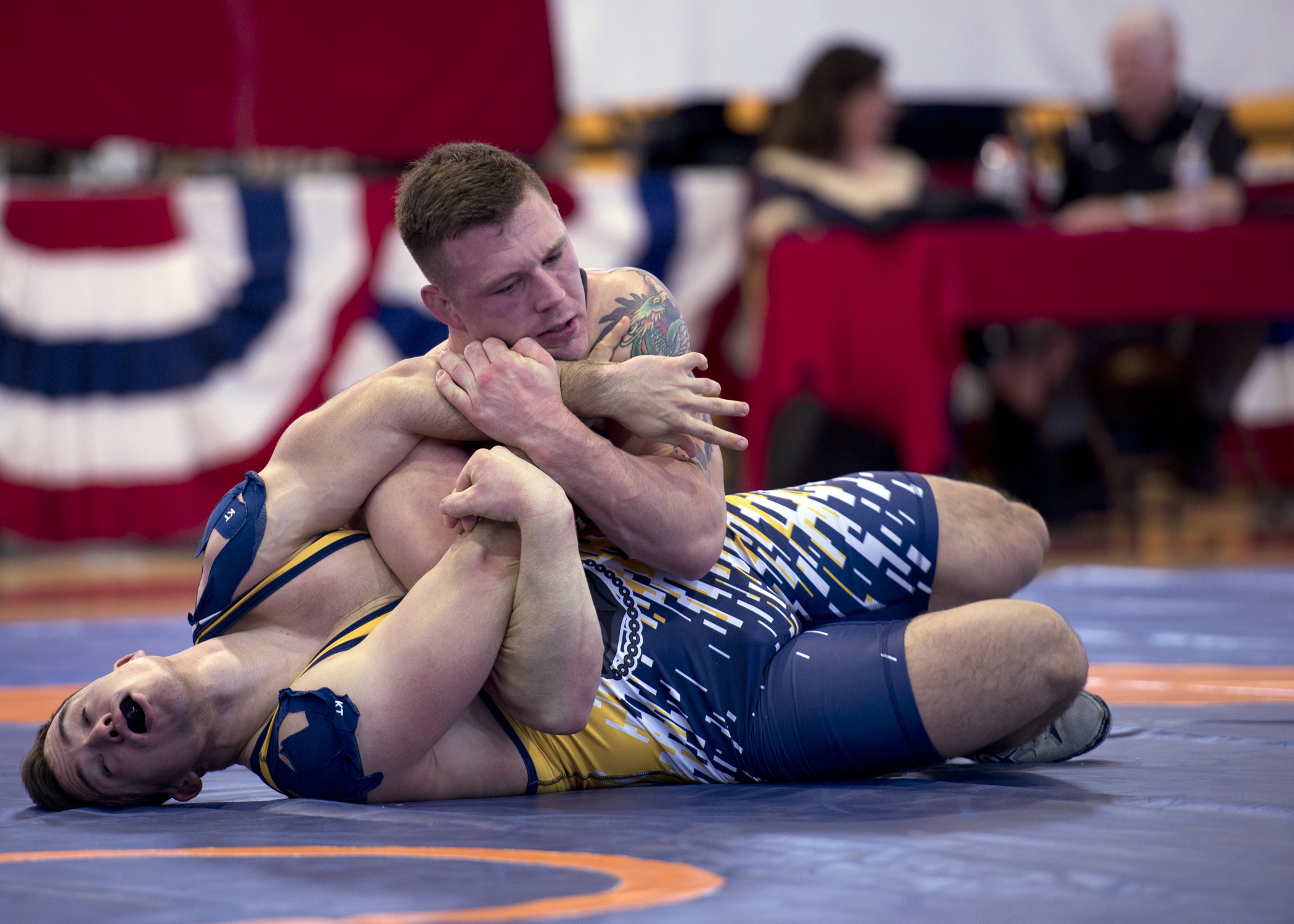 Marine Sgt. John Stefanowicz, from Kennerdell Pa., pins Navy Petty Officer Joseph Marques from Punta Gorda, Fla., during the 82 kg weight class of the 2018 Armed Forces Wrestling Championship Greco-Roman competition. Stefanowicz is a member of the Armed Forces Sports program's All-Marine wrestling team. AFS All-Service teams provide servicemembers opportunities to participate in national and international competitions including the Military World Games and the Olympics. (MCS1Gulianna Dunn/Navy)