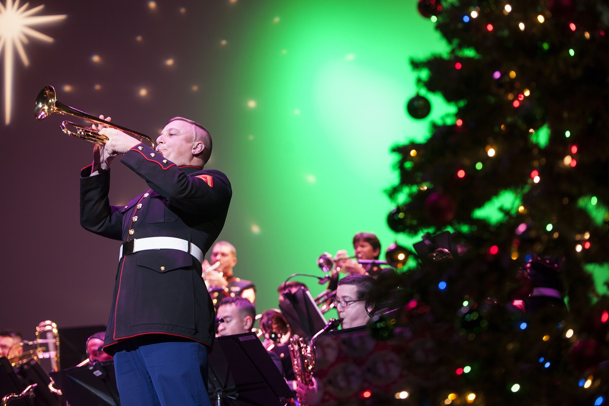 "Lance Cpl. Christopher Lyman, a musician with Marine Corps Band New Orleans, plays the trumpet during the ""Santa Meets Sousa"" holiday concert at the Saenger Theatre, New Orleans, Dec. 9, 2017. The performance was one of several holiday concerts the band arranged throughout December to promote the Marine Corps Reserve Toys for Tots program, which donates toys to less fortunate children in the community. (Lance Cpl. Tessa D. Watts/Marine Corps)"