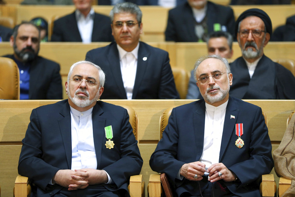 Chief of Iran's Atomic Energy Organization Ali Akbar Salehi, right, sits next to Foreign Minister Mohammad Javad Zarif after being awarded a medal of honor by President Hassan Rouhani during a ceremony in Tehran, Iran, on Feb. 8, 2016. (Ebrahim Noroozi/AP)