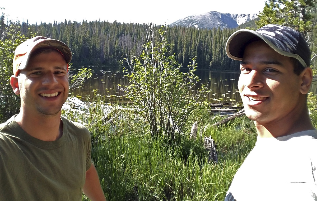 In this July 7, 2017, Marine Pfc. Ali Alkazahg, right, poses with Trevor Reilly, left, while hiking in the Eagles Nest Wilderness of the Dillon Ranger District in Colorado. (Trevor Reilly via AP)