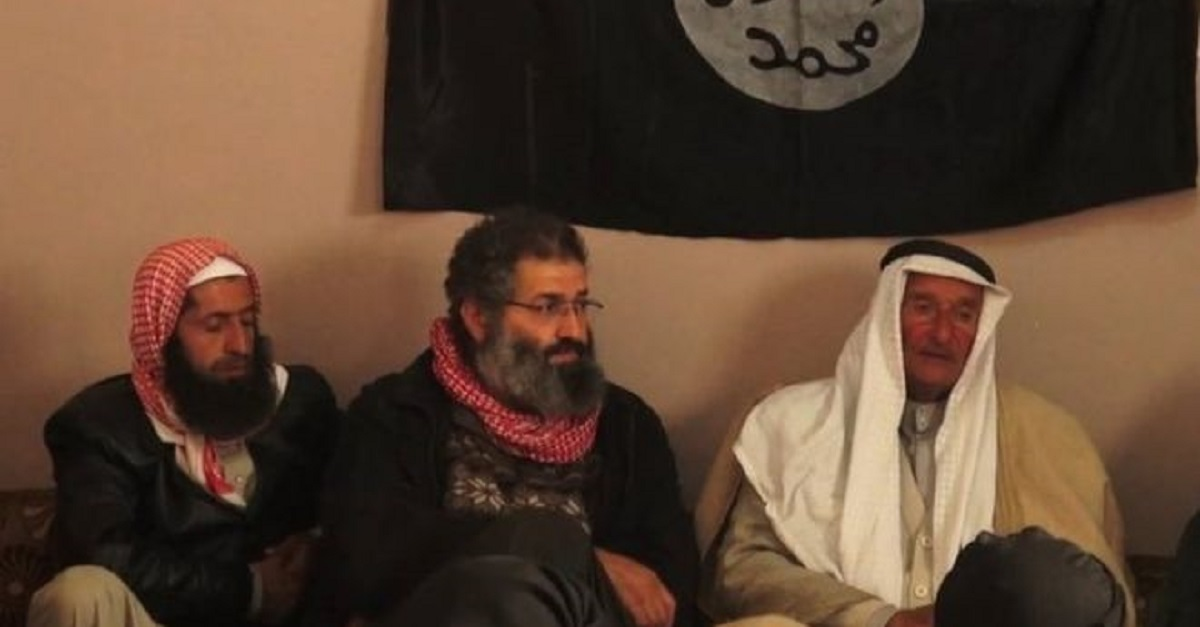 U.S.-backed forces in Syria have detained Mohammed Haydar Zammar, who claims to have recruited the men who attacked the U.S. on Sept. 11, 2001. In 2014, Zammar, center, was photographed at a meeting between IS militants and Syrian tribesmen. (Twitter/@BJOERNSTRITZEL)