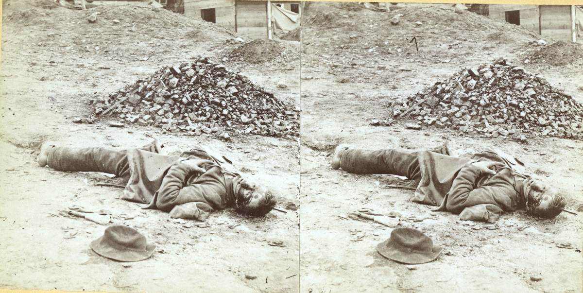 This photograph was taken April 2, 1865, in the Rebel trenches at Petersburg just after their capture by the Union troops. The trenches all along the lines were found to contain many dead Confederates, and this view is but one of many that was made by the photographer showing the dead just as they fell. By looking at a number of these views you can get an idea of how a long stretch of the trenches looked that day. Of course the camera could not take but a small section within the scope of each view. You will notice that no two of the dead fell in the same position. (original caption of the stereograph/ National Archives)