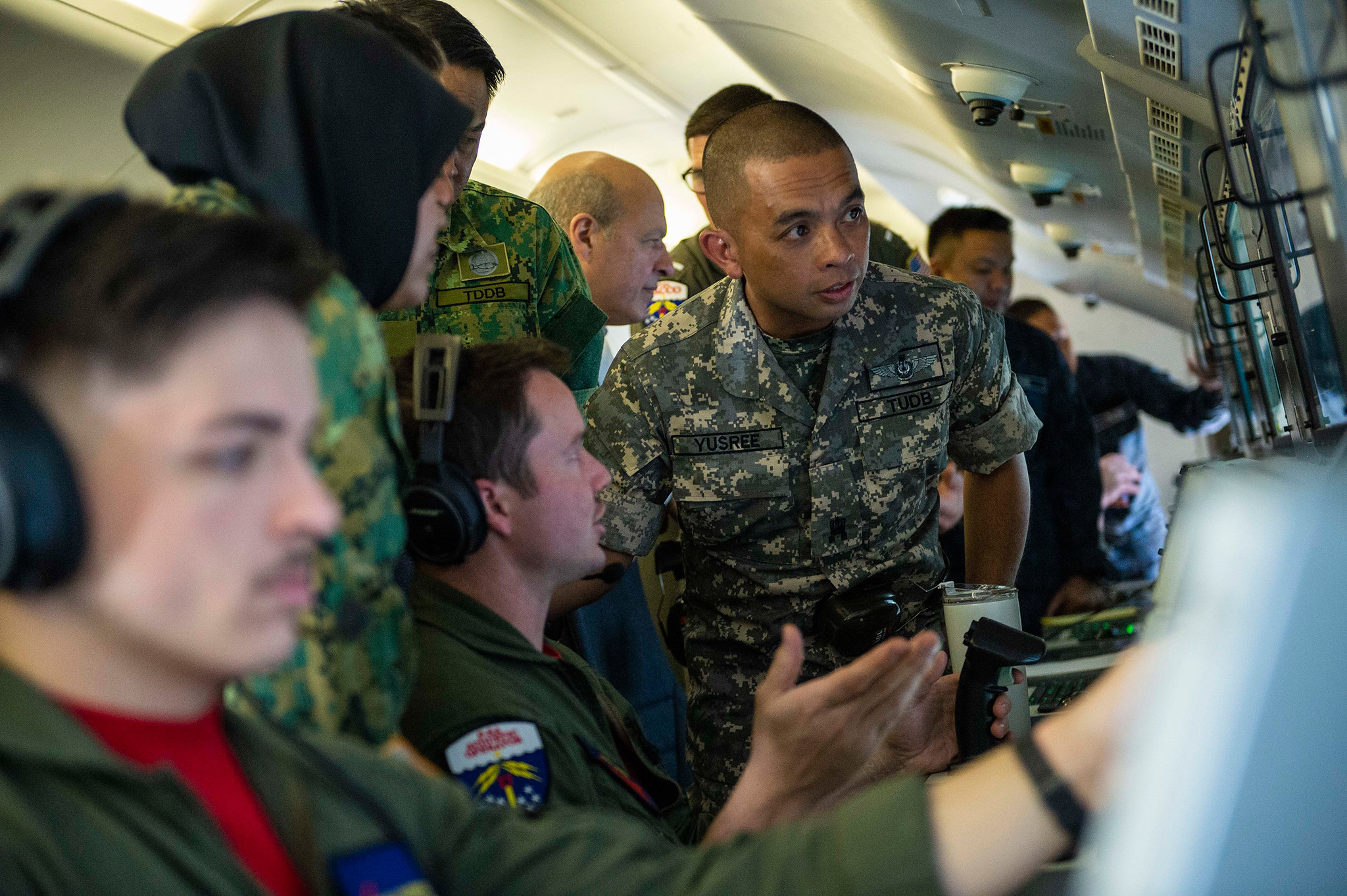 Royal Brunei armed forces discuss aircraft capabilities with U.S. Navy sailors inside a P-8 Poseidon aircraft on Oct. 23, 2019, during a distinguished visitor tour of the aircraft in support of Cooperation Afloat Readiness and Training (CARAT) Brunei at Rimba Air Base. (Mass Communication Specialist 2nd Class Christopher A. Veloicaza/Navy)