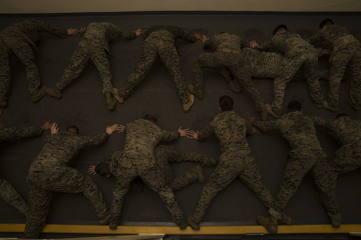 Marines exercise during a Marine Corps Martial Arts Program course aboard the San Antonio-class amphibious transport dock USS Anchorage (LPD 23), Dec. 10, 2018, in the U.S. 5th Fleet area of operations. (Sgt. Austin Mealy/Marine Corps)