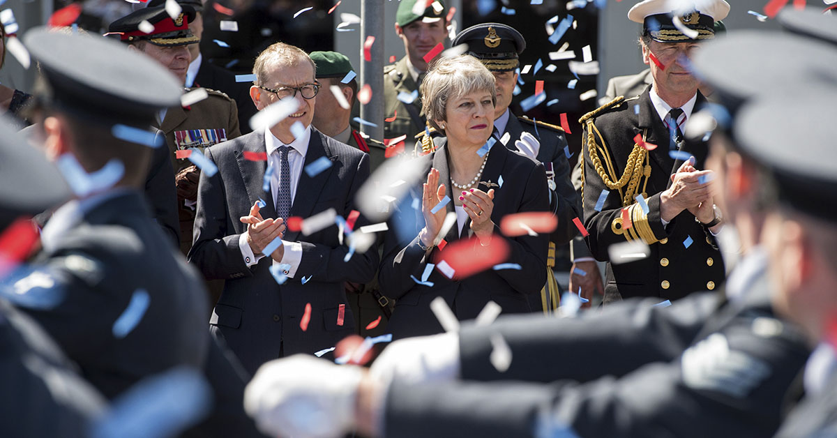 Military personnel parade past British Prime Minister Theresa May, center, and dignitaries during the national Armed Forces Day celebrations at Llandudno, north Wales, on June 30, 2018. (Oli Scarff/AFP via Getty Images)