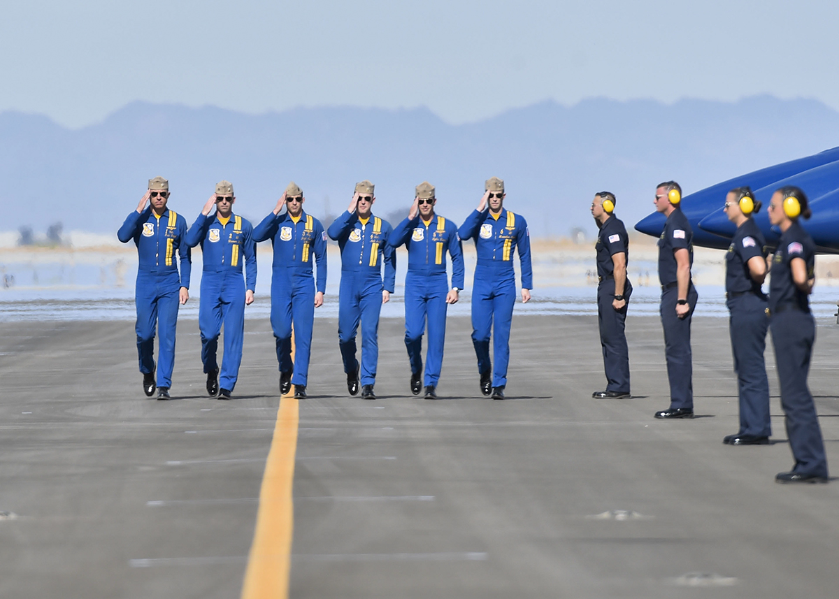 Pilots assigned to the U.S. Navy flight demonstration squadron, the Blue Angels, walk down the flightline prior to a practice demonstration at NAF El Centro, California. The Blue Angels are scheduled to perform more than 60 demonstrations at more than 30 locations across the U.S. in 2018. (MC2 Jess Gray/Navy)