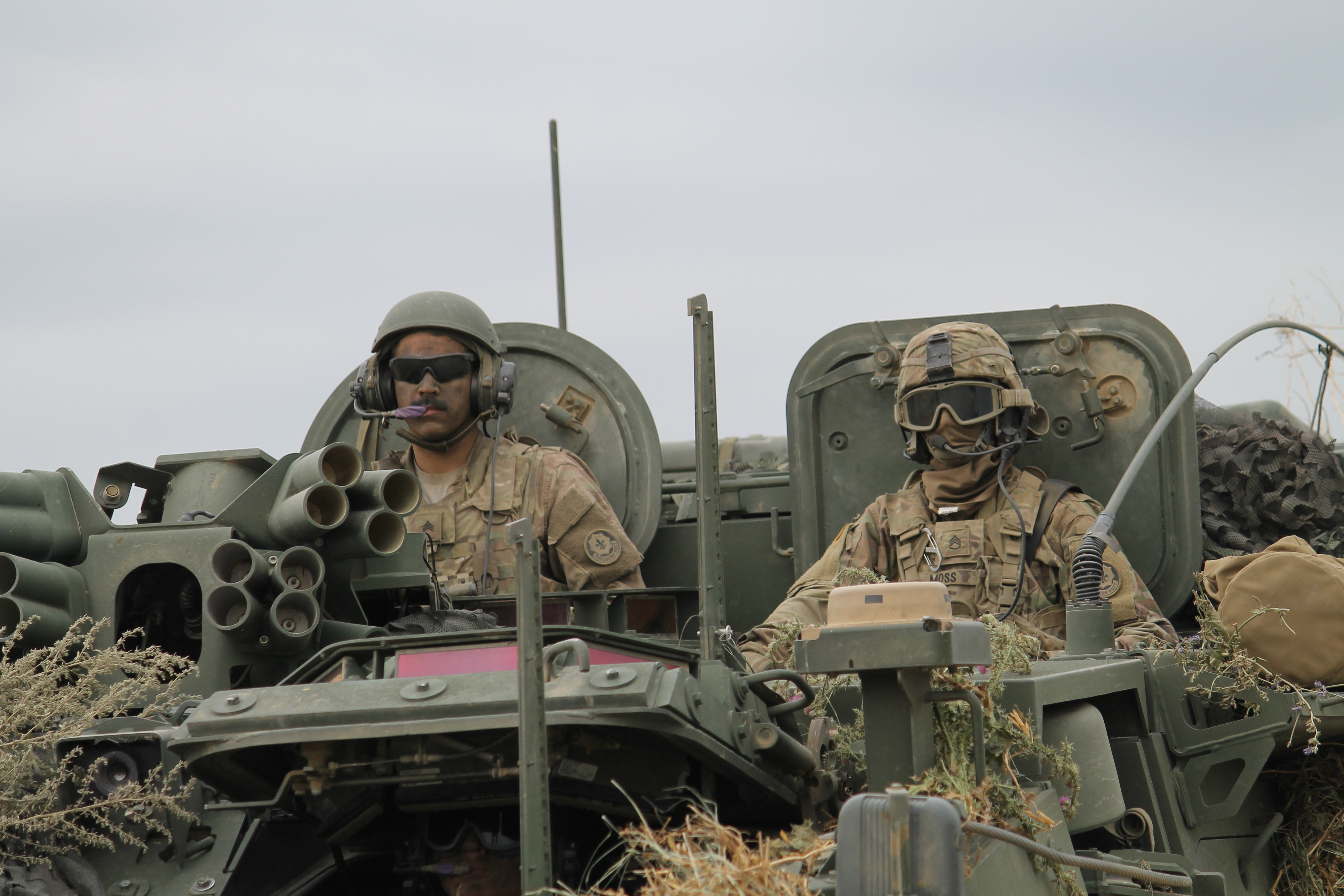 U.S. Stryker operators prepare to drive the vehicle onto the pontoon bridge after Romanian forces have used a variety of capabilities within a multidomain battle scenario to secure the area for the crossing. (Jen Judson/Staff)