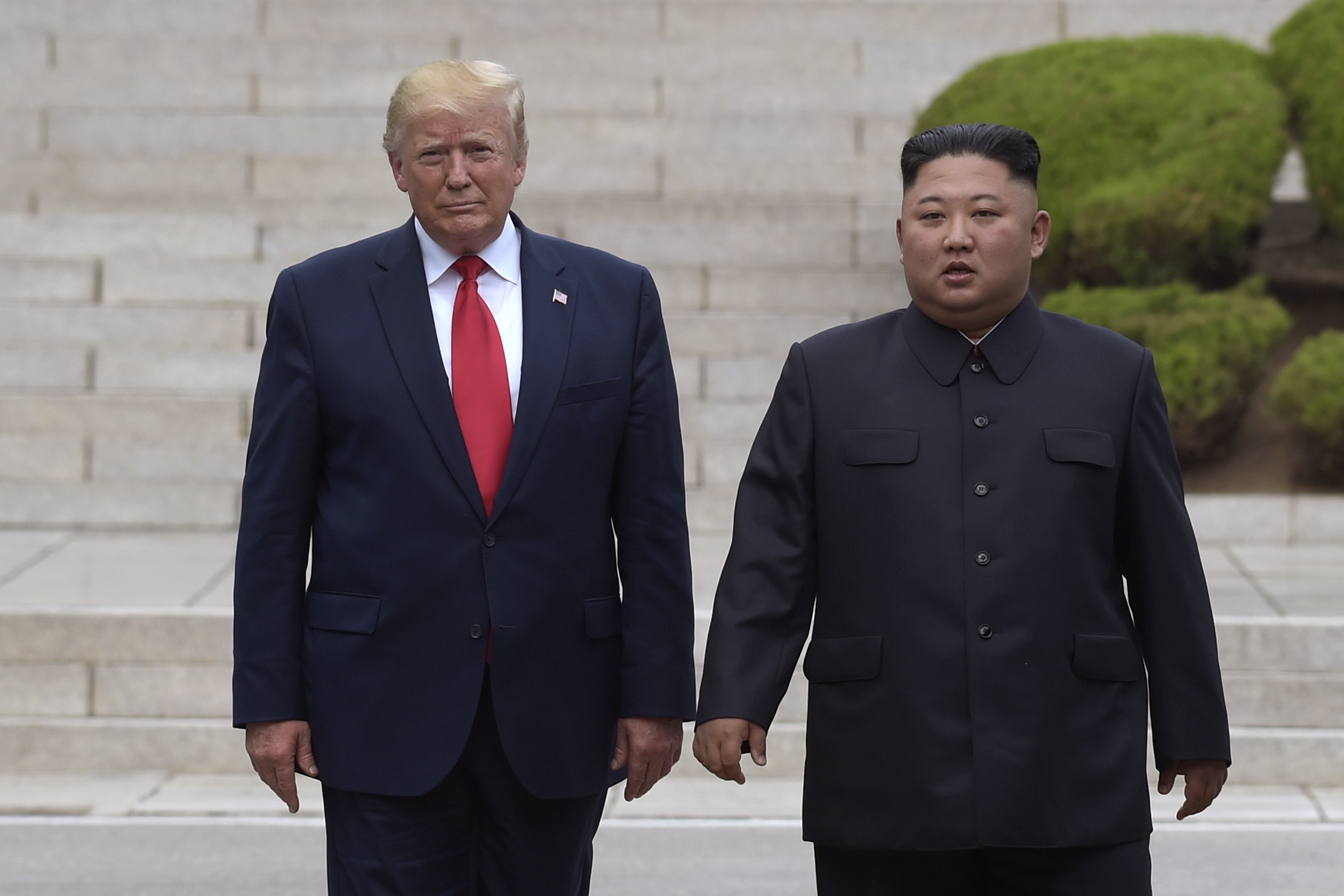 In this June 30, 2019, file photo, U.S. President Donald Trump, left, meets with North Korean leader Kim Jong Un at the North Korean side of the border at the village of Panmunjom in Demilitarized Zone. (Susan Walsh/AP)