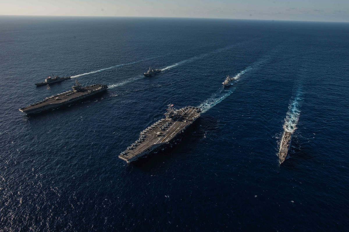 Ships with the Ronald Reagan and John C. Stennis carrier strike groups transit the Philippine Sea during dual carrier operations Nov. 16. The Navy's plan to build a gigantic fleet may be under pressure with new cuts in the offing. (U.S. Navy photo by MC2 Kaila Peters)