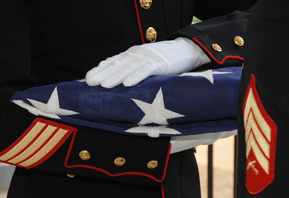 Deported Marine veteran Enrique Salas was buried with military honors Friday. Pictured: Marines conduct a military funeral for a fallen service member at Andersonville National Cemetery, Andersonville, Ga. (Capt. Justin Jacobs/Marine Corps)