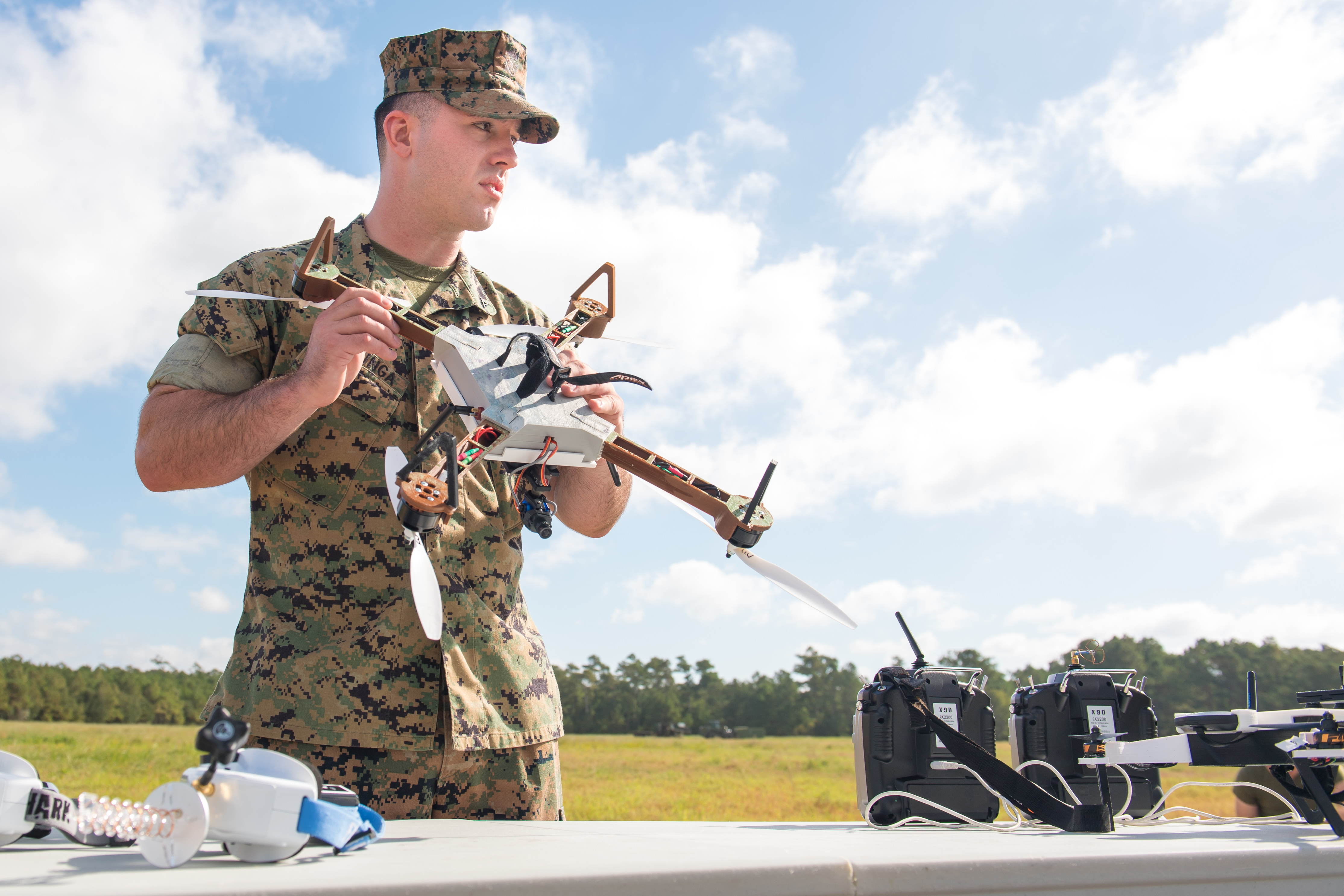Lance Cpl. Nicholas Hettinga, gets familiar with a 3-D printed Army drone prototype during training at Camp Lejeune, North Carolina, Sept. 27, 2017. (Army)