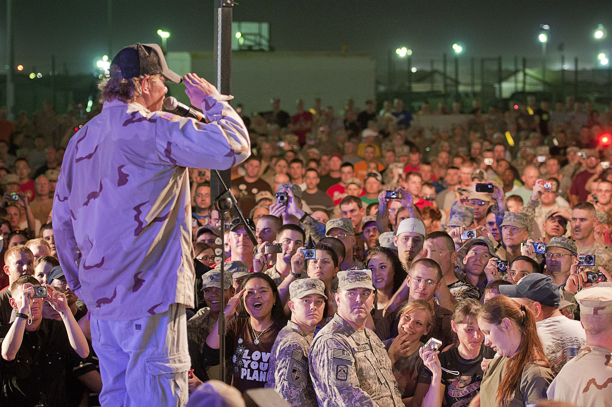 Toby Keith proudly salutes troops as part of a USO tour to Camp Arifjan, Kuwait, April 2011. (Dave Gatley/USO)