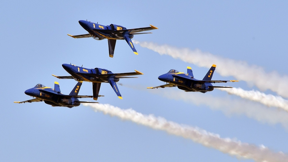 Members of the Blue Angels perform the Double Farvel during an air show. If budget cuts come through in 2020, the Blue Angels' season is facing the budget ax. (MC2 Ian Cotter/U.S. Navy)