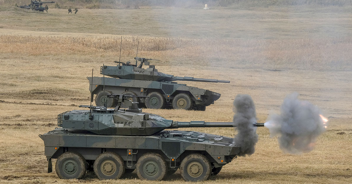 Type 16 maneuver combat vehicles take part in an airborne exercise of the Japanese Ground Self-Defence Force 1st Airborne Brigade at Narashino training ground in Funabashi, Chiba prefecture, Japan. (Photo by KAZUHIRO NOGI/AFP via Getty Images)