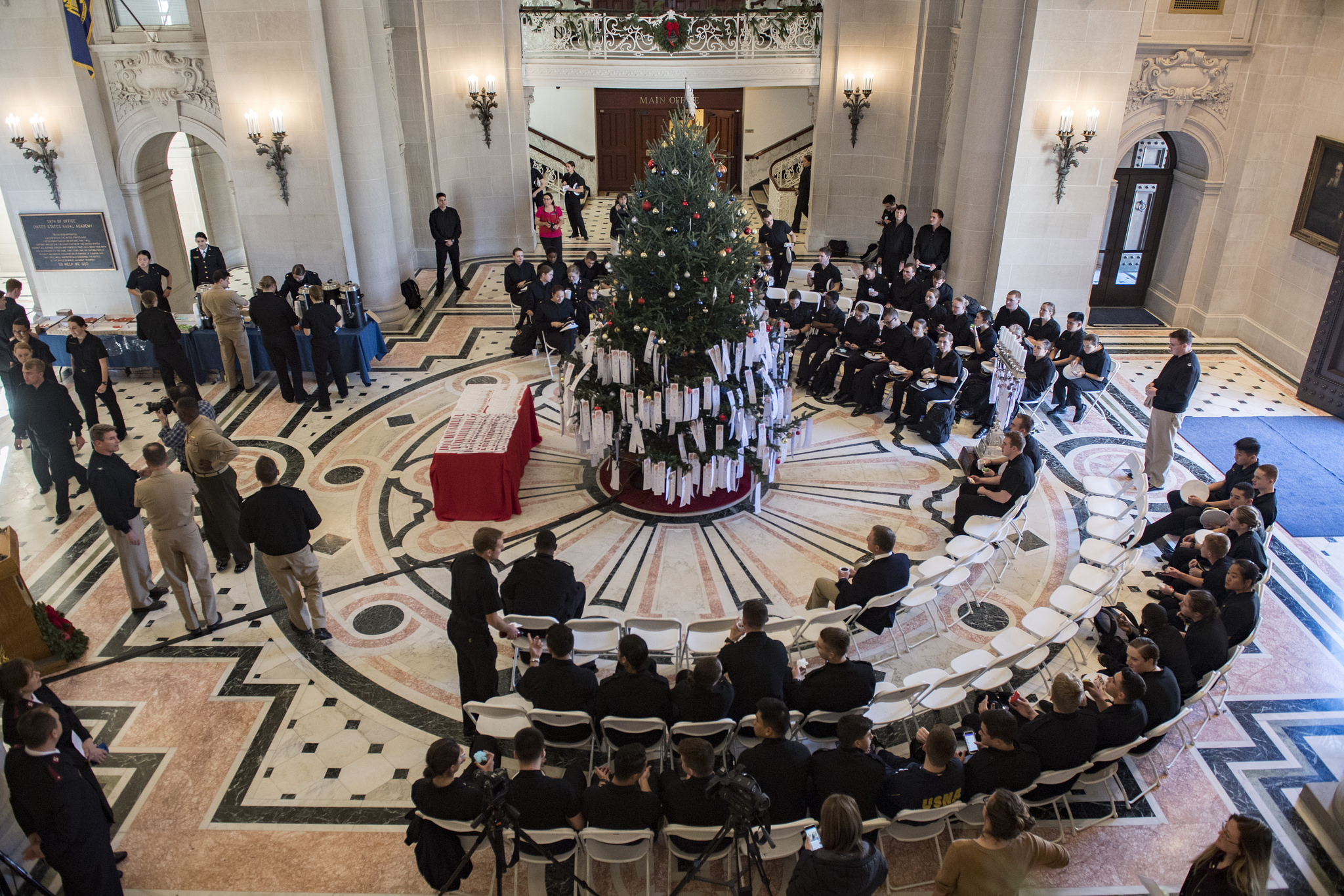 The U.S. Naval Academy holds the 27th annual Giving Tree ceremony Nov. 28, 2017, in Bancroft Hall at Annapolis, Md. (US Naval Academy)