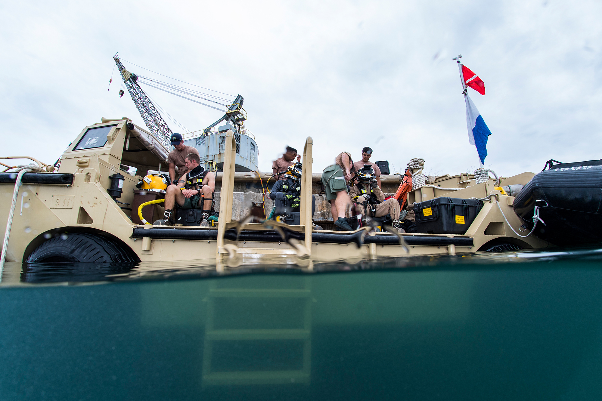 U.S. Navy Seabees, assigned to Underwater Construction Team (UCT) 2, prepare for underwater welding operations at Naval Base Guam, Oct. 19, 2017. UCT-2 provides responsive inshore and underwater construction capabilities under the guidance of Commander, Task Force 75. (Specialist 1st Class Arthurgwain L. Marquez/Navy)