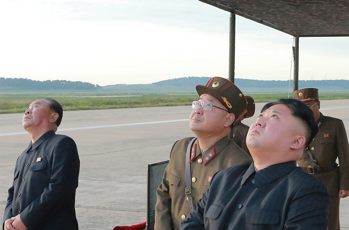 North Korean leader Kim Jong Un, right, watches what was said to be the test launch of an intermediate-range Hwasong-12 missile at an undisclosed location in North Korea in this undated image. The North tested that missile type Aug. 28, 2017. (Korean Central News Agency/Korea News Service via AP)