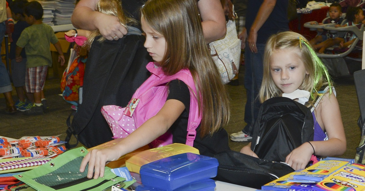 Operation Homefront's Backpack Brigade has been in effect for a decade, helping military families of those E-6 and below cover school costs at multiple locations, including here at Naval Air Station Joint Reserve Base Fort Worth, Texas. (Senior Master Sgt. Elizabeth Gilbert/Air National Guard)