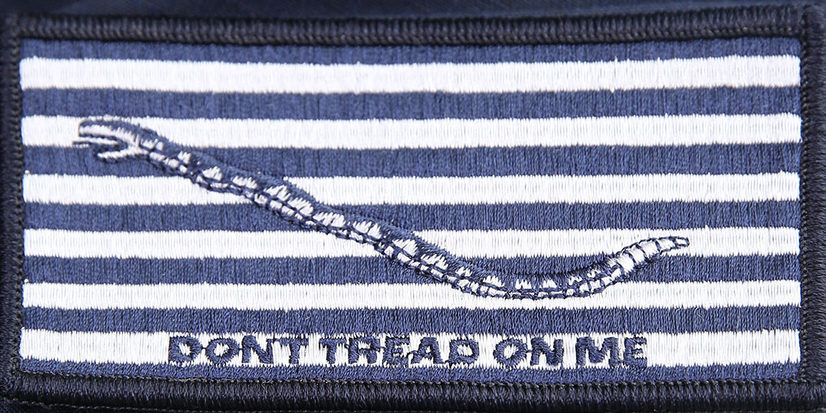 The monochromatic command patch is highlighted for the modernized, two-piece, flame-resistant organizational clothing wear-test design components for sailors. (Mass Communication Specialist 2nd Class Michael Fiorillo/Navy)