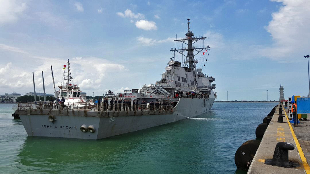 U.S. Navy guided-missile destroyer John S. McCain arrives pierside at Changi Naval Base, Singapore, following a collision with the merchant vessel Alnic MC. (MC2 Joshua Fulton/U.S. Navy via Getty Images)