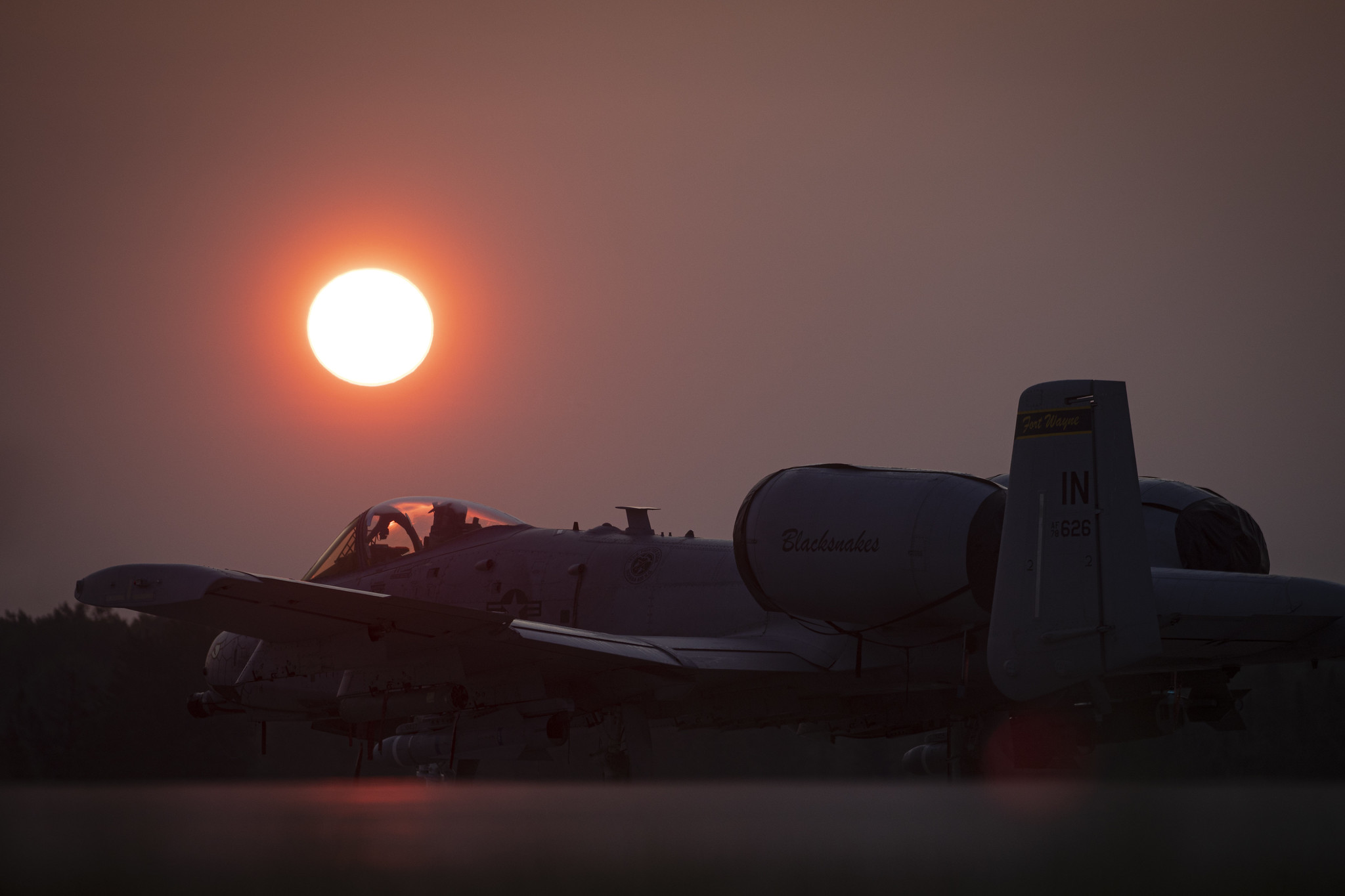An Air Force A-10C Thunderbolt II sits on the flightline at sunrise during Northern Strike 19 at the Alpena Combat Readiness Training Center, Mich., July 26, 2019. (Master Sgt. Matt Hecht/Air National Guard)
