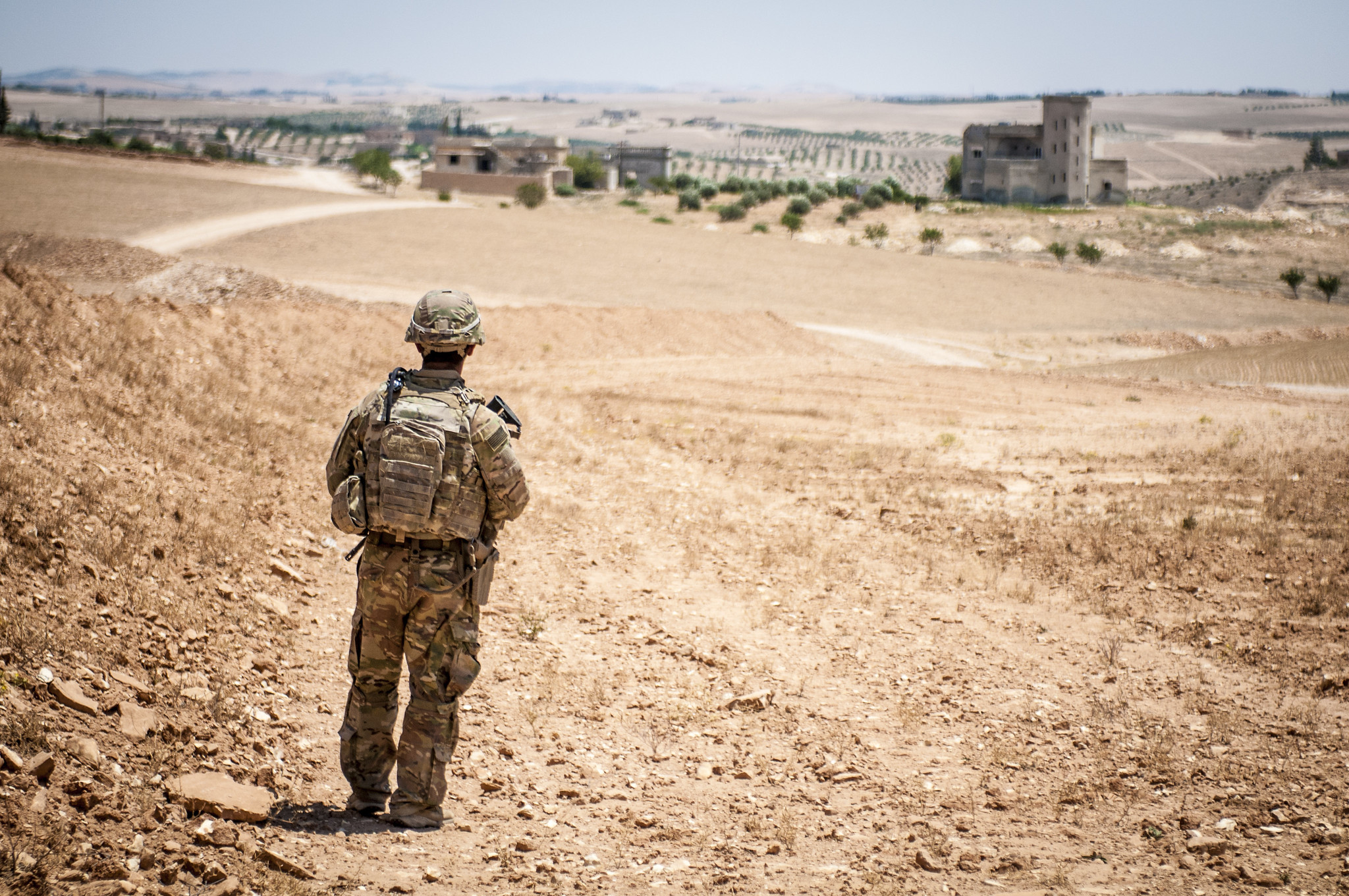 A U.S. soldier provides security during a coordinated, independent patrol along the demarcation line near a village outside Manbij, Syria. (Staff Sgt. Timothy R. Koster/Army)