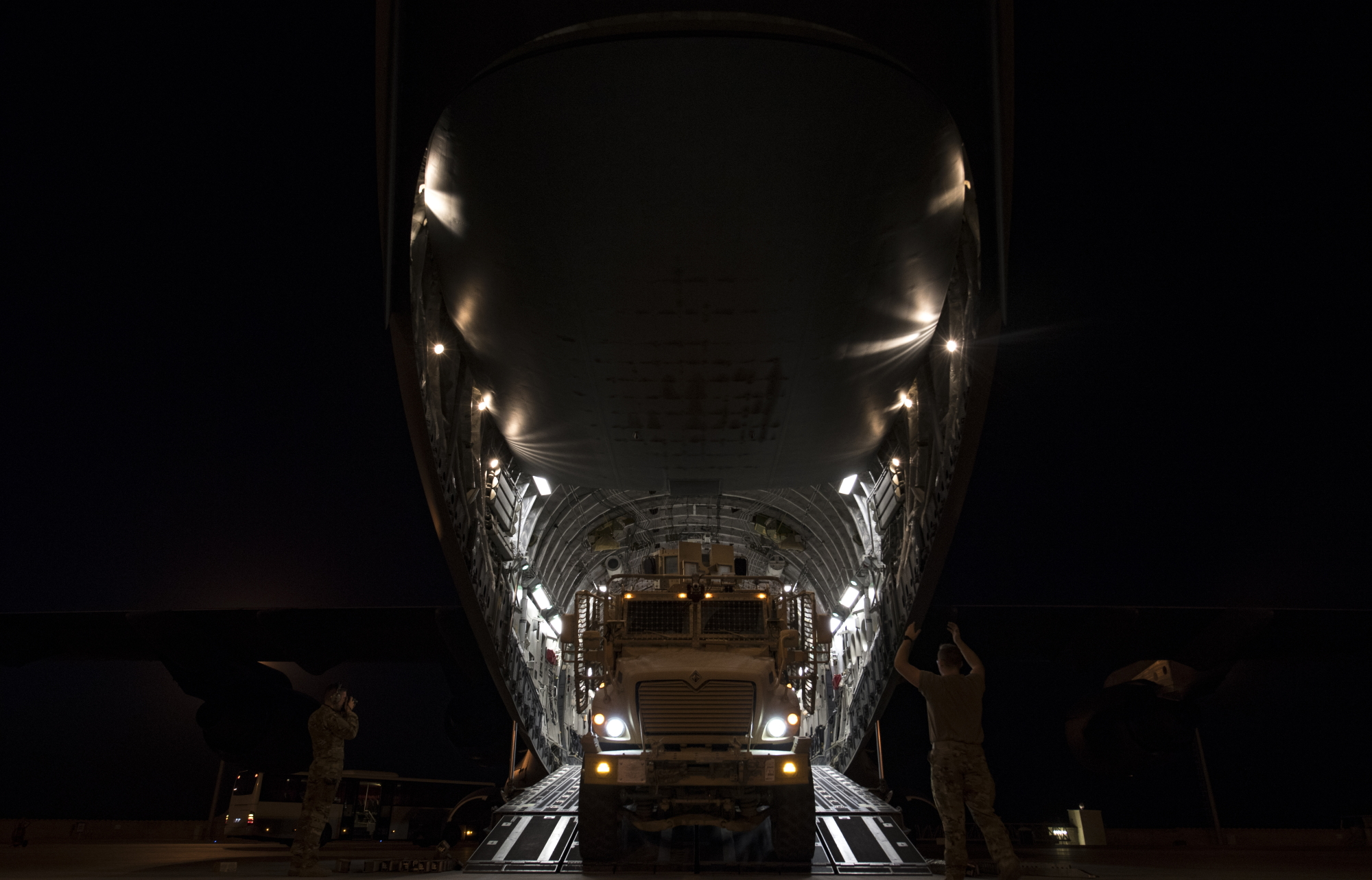 Airmen unload cargo off a C-17 Globemaster III at Bagram Airfield, Afghanistan, Oct. 20, 2019. (Staff Sgt. Matthew Lotz/Air Force)