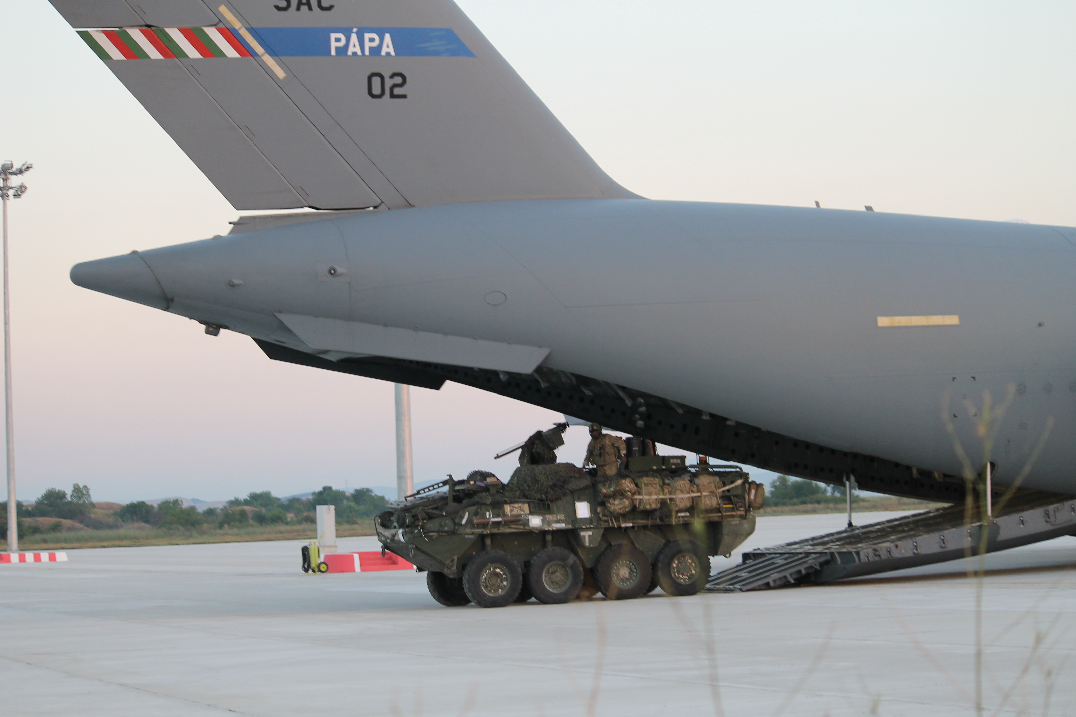 A U.S. Stryker drives out of the C-17. The aircraft was holding two vehicles. Another C-17 was not far behind, delivering another two Strykers for the operation. (Jen Judson/Staff)