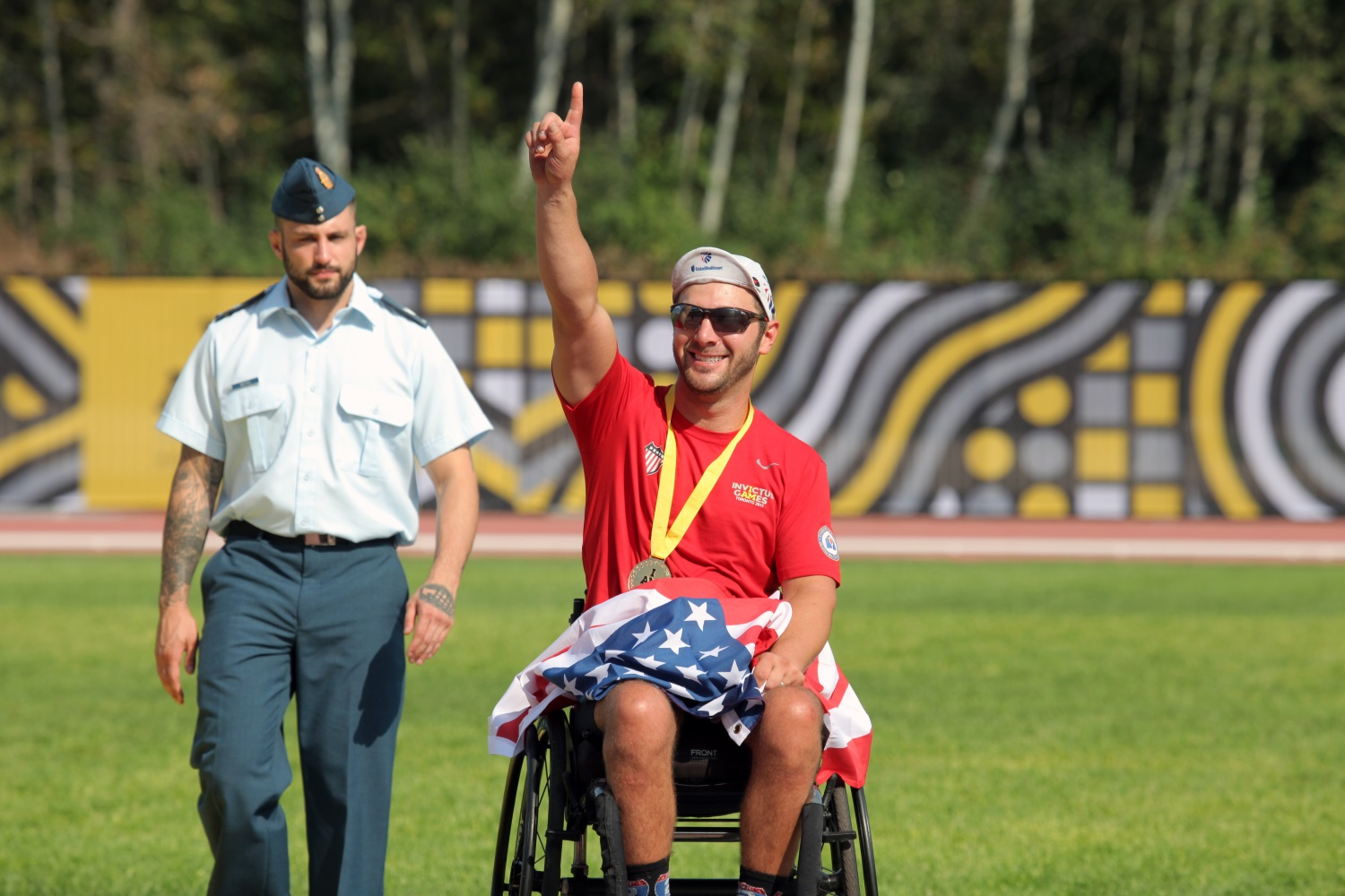 U.S. Navy veteran Nathan Dewalt places gold at the Invictus Games' track event, at York Lions Stadium in Toronto, Canada, on Sept. 24, 2017. (Staff Sgt. Daniel Luksan/Army)
