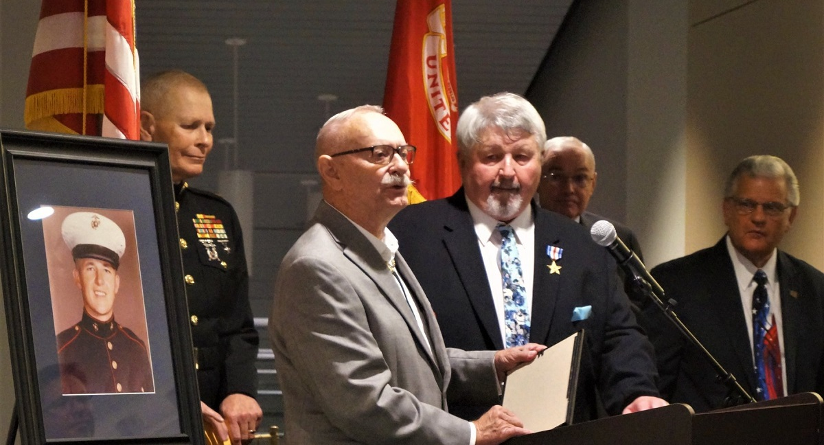 Lance Cpl. Raymond Kelley (center) was awarded the Silver Star for his heroic actions during the Vietnam War 51 years after the incident. (National Museum of the Marine Corps)