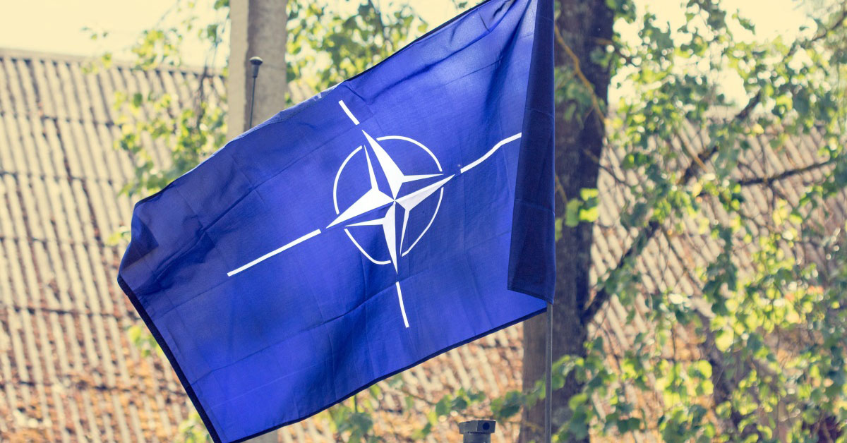 How much do NATO member nations spend on defense?