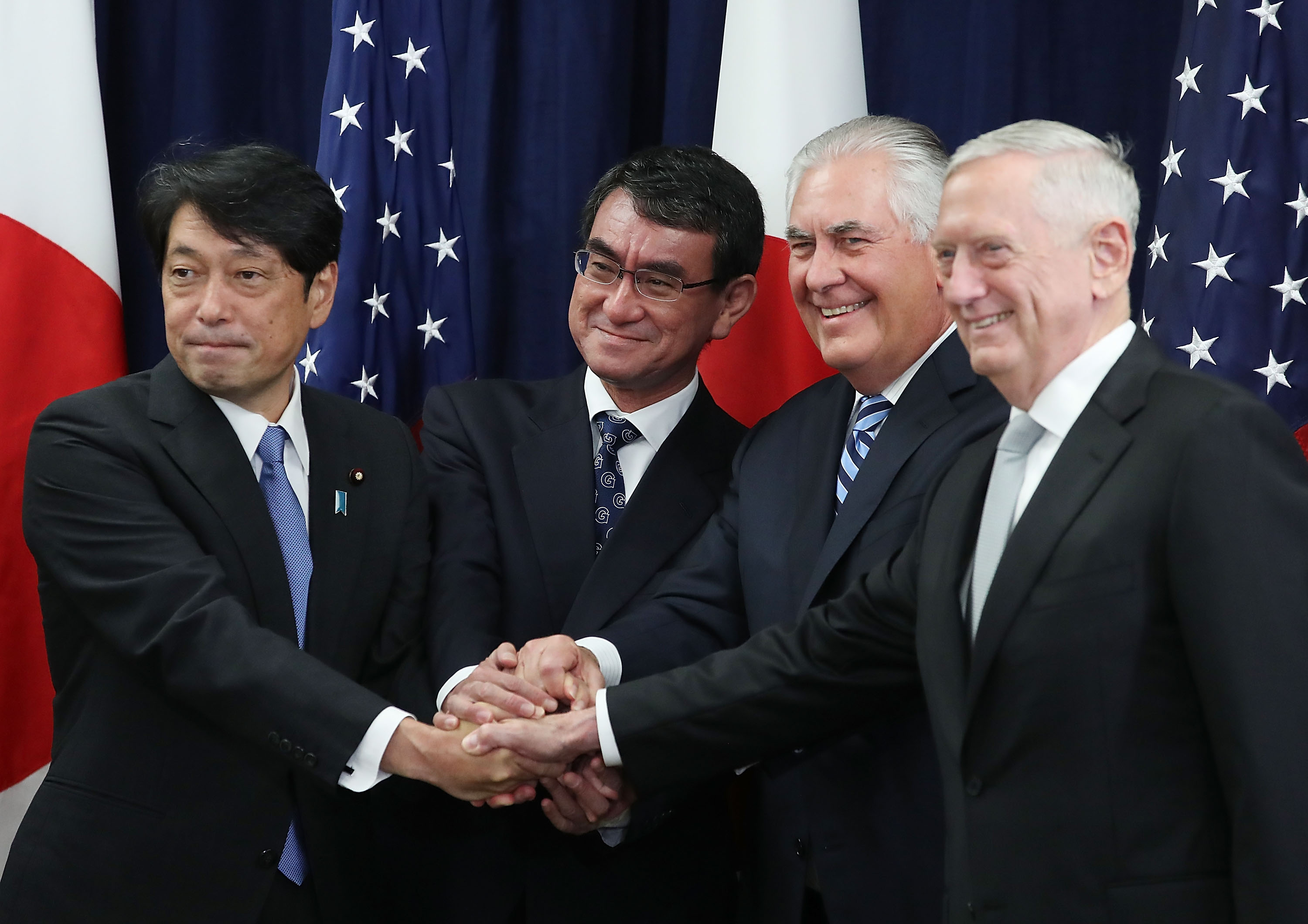 Secretary of State Rex Tillerson (2ndR), Defense Secretary James Mattis (R), shake hands with Japanese Foreign Minister Taro Kono (2ndL) and Defense Minister Itsunori Onodera (L), during a meeting of the U.S.-Japan Security Consultative Committee at the State Department, on August 17, 2017 in Washington, DC. (Mark Wilson/Getty Images)