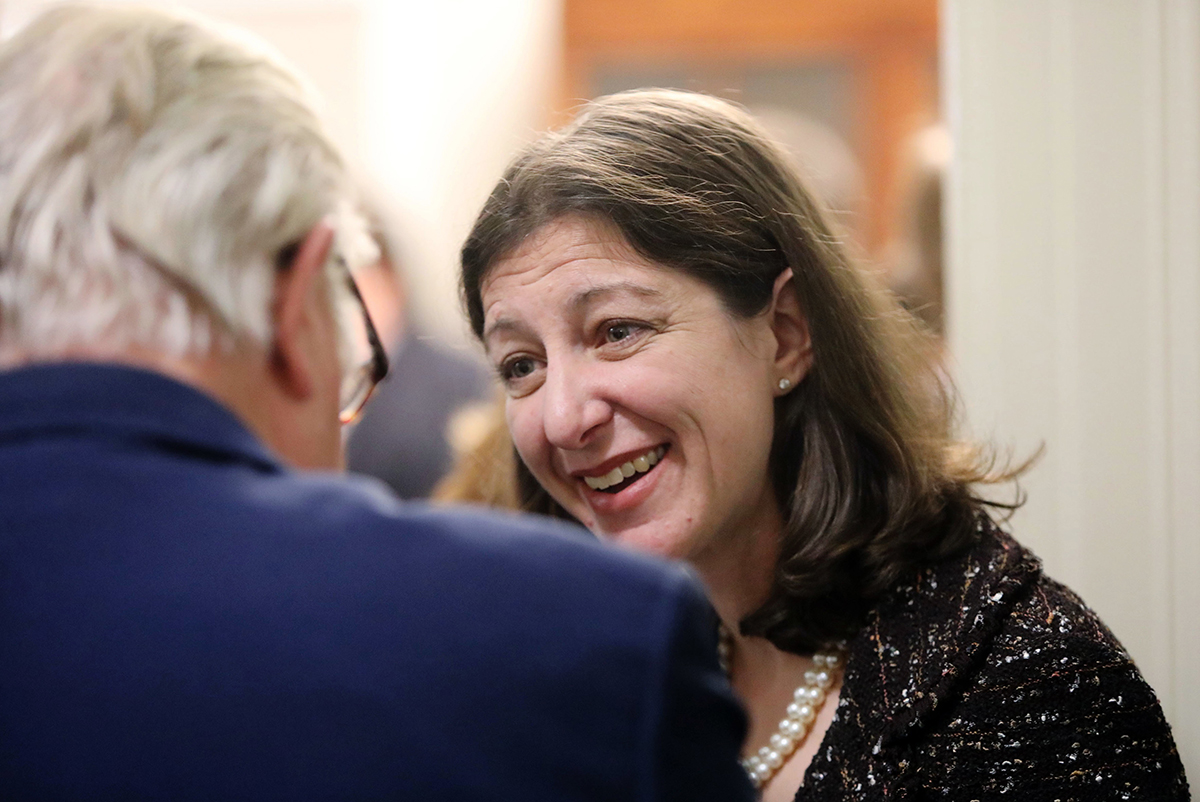 Elaine Luria, a Democratic representative from Virginia's 2nd Congressional District, greets guests at a reception before she is sworn in to Congress, Thursday, Jan. 3, 2019, in Washington. The former Navy commander defeated Republican Scott Taylor, a former Navy SEAL, in November to take over his seat. (Steve Earley/The Virginian-Pilot via AP)