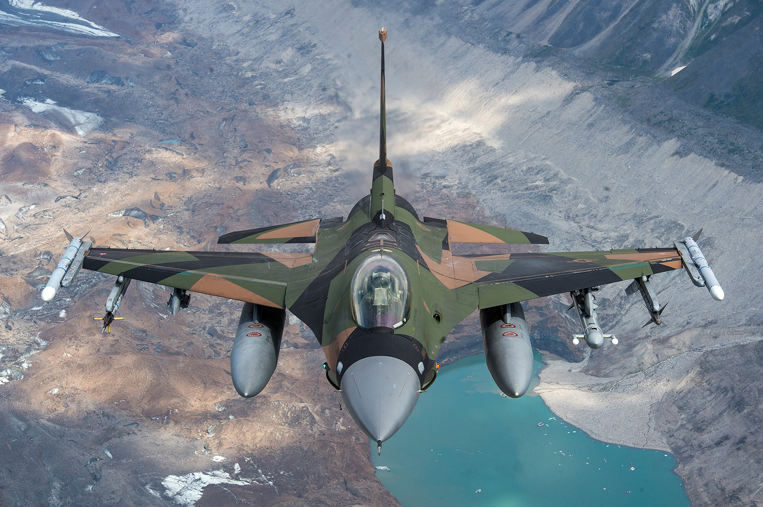 An Air Force F-16 Fighting Falcon from Eielson Air Force Base flies in formation over the Joint Pacific Alaska Range Complex, July 18, 2019. (Staff Sgt. James Richardson/Air Force)