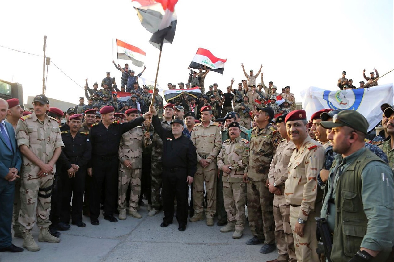 Iraqi prime minister declares 'total victory' in Mosul over ISIS