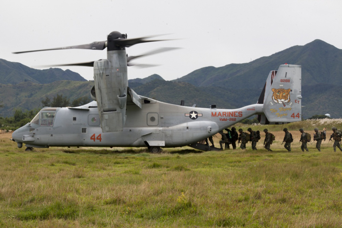 Philippine Marines load onto an MV-22B Osprey tiltrotor aircraft on Oct. 8, 2017, during exercise KAMANDAG at Colonel Ernesto P. Ravina Air Base, Philippines. (Cpl. Stormy Mendez/Marine Corps)