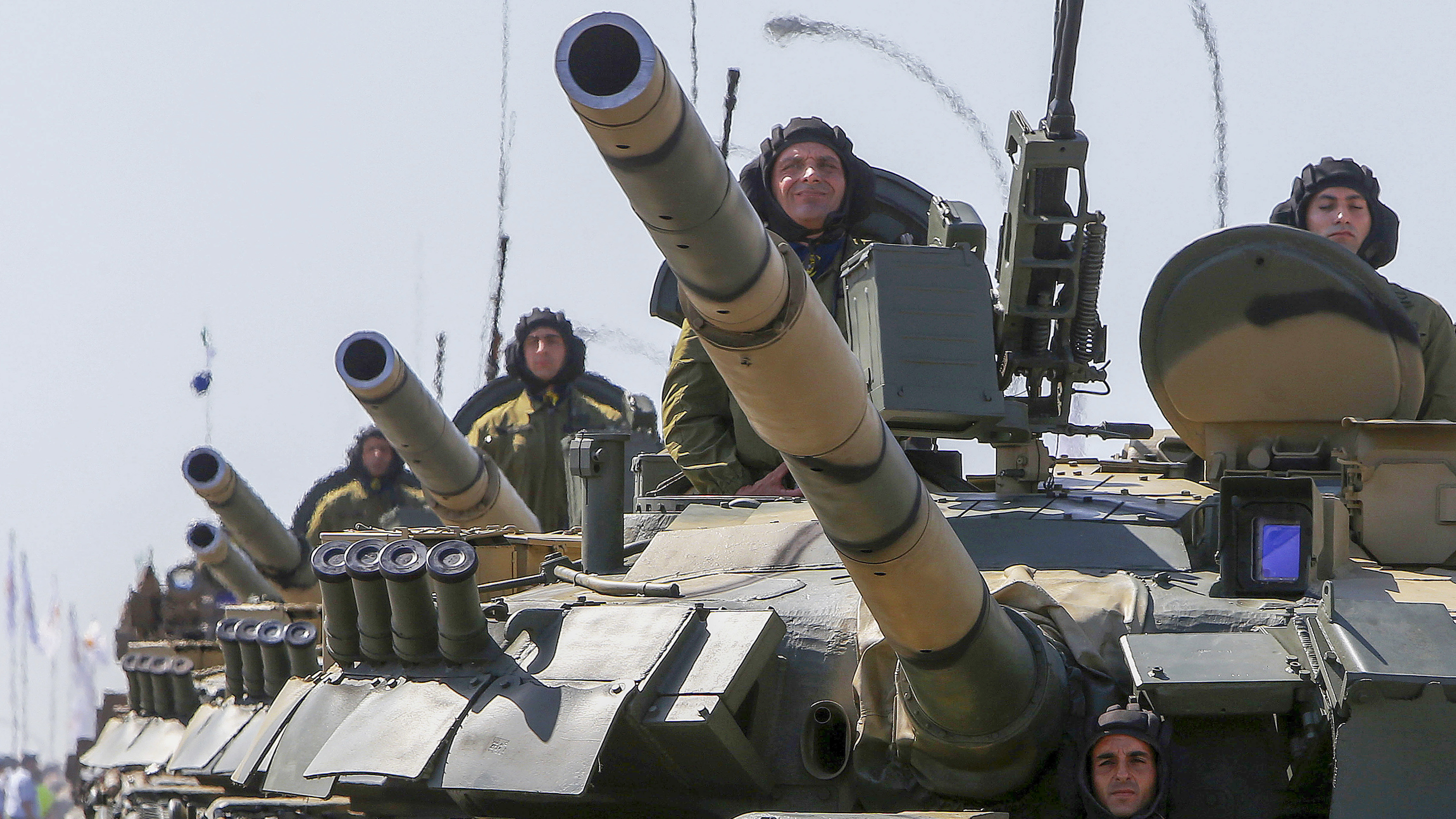 Cypriot soldiers travel on Russian-made tanks during a military parade celebrating 58 years of independence in Nicosia in the divided island of Cyprus, Monday, Oct. 1, 2018. The island of Cyprus has been divided since 1974, when Turkey invaded in response to a coup aimed at uniting the island with Greece. Cyprus gained independence from Britain in 1960. (AP Photo/Petros Karadjias)
