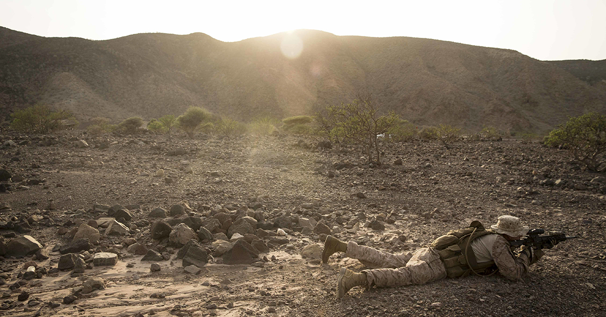 Lance Cpl. Riley Crider, a machine gunner assigned to Kilo Company, Battalion Landing Team 3/1, 13th Marine Expeditionary Unit, waits for orders during a fire team maneuver drill while participating in Theater Amphibious Combat Rehearsal (TACR) 18 in Djibuouti. (Cpl. Danny Gonzalez/Marine Corps)