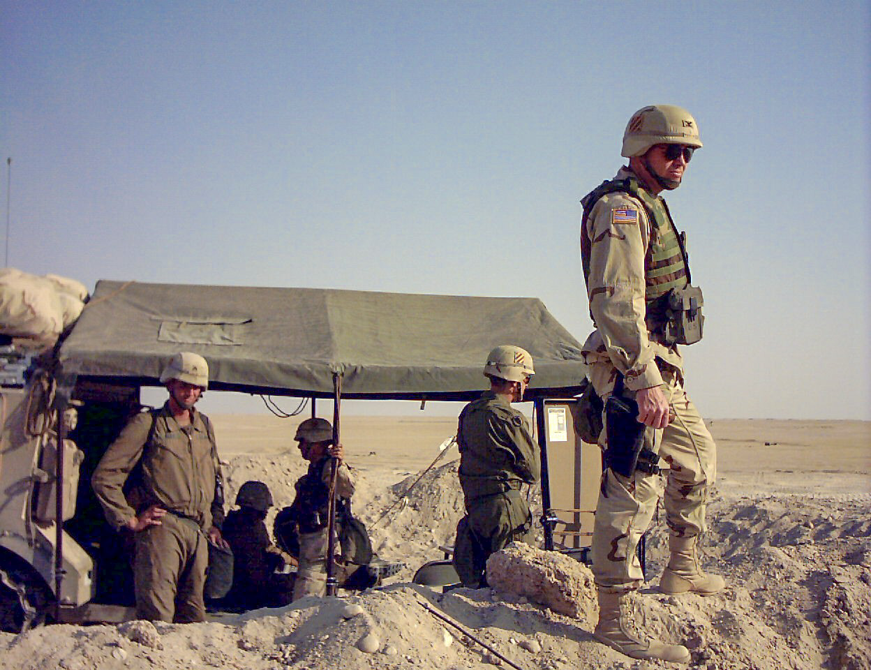 Col. David Perkins, Spartan 6, surveys his surroundings while preparing to invade Iraq during his tenure as the commander of 2nd Brigade, 3rd Infantry Division, in February 2003. (Army)