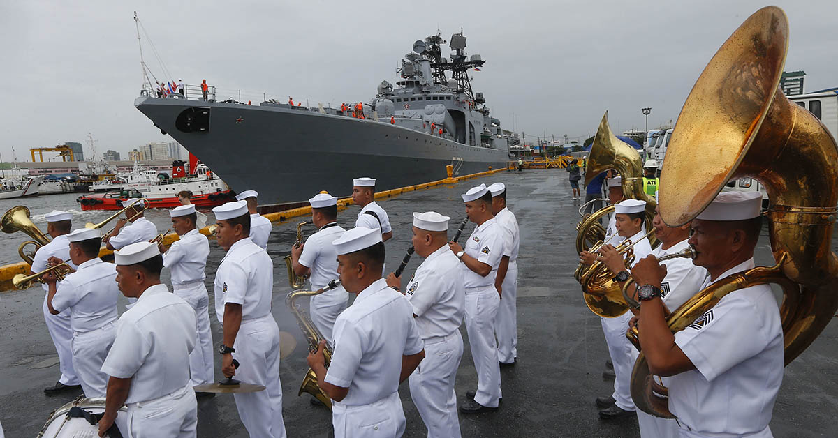 The Philippine Navy band plays a marching song to welcome the Russian Navy anti-submarine ship Admiral Vinogradov as it docks for a five-day goodwill visit along with another ship, Admiral Tributs, and the sea tanker Pechenga on June 9, 2018. (Bullit Marquez/AP)