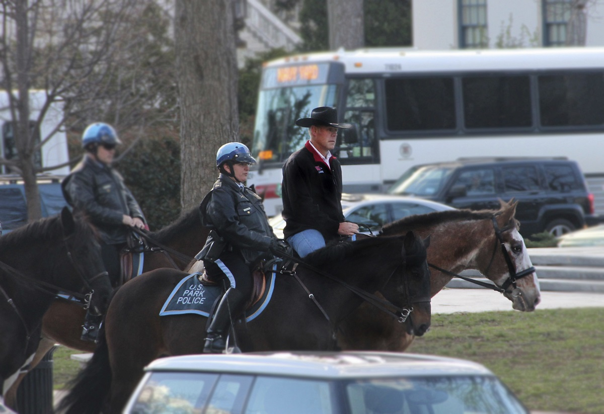 In this photo provided by the Interior Department shows Interior Secretary Ryan Zinke arriving for his first day of work at the Interior Department in Washington, Thursday, March 2, 2017, aboard Tonto, an 17-year-old Irish sport horse. Zinke will be leaving the administration at year's end, Trump said Saturday, Dec. 15, 2018. (Interior Department via AP)