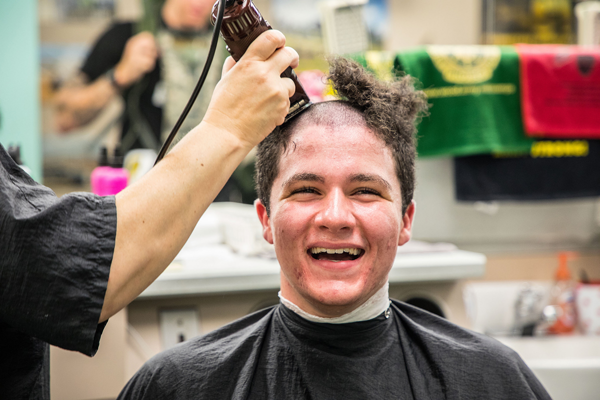 A new cadet receives his first of many haircuts at the U.S. Military Academy at West Point on July 2, 2018, during Reception Day. (Michelle Eberhart/Army)