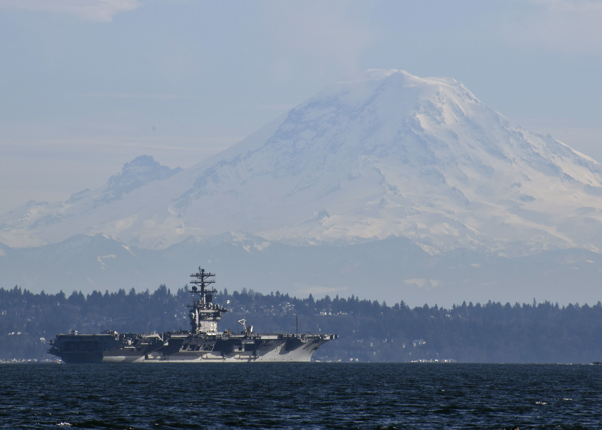 The aircraft carrier Nimitz (CVN 68) passes Mount Rainier while transiting Puget Sound on Feb. 21, 2020. (Mass Communication Specialist Seaman Olivia Banmally Nichols/Navy)