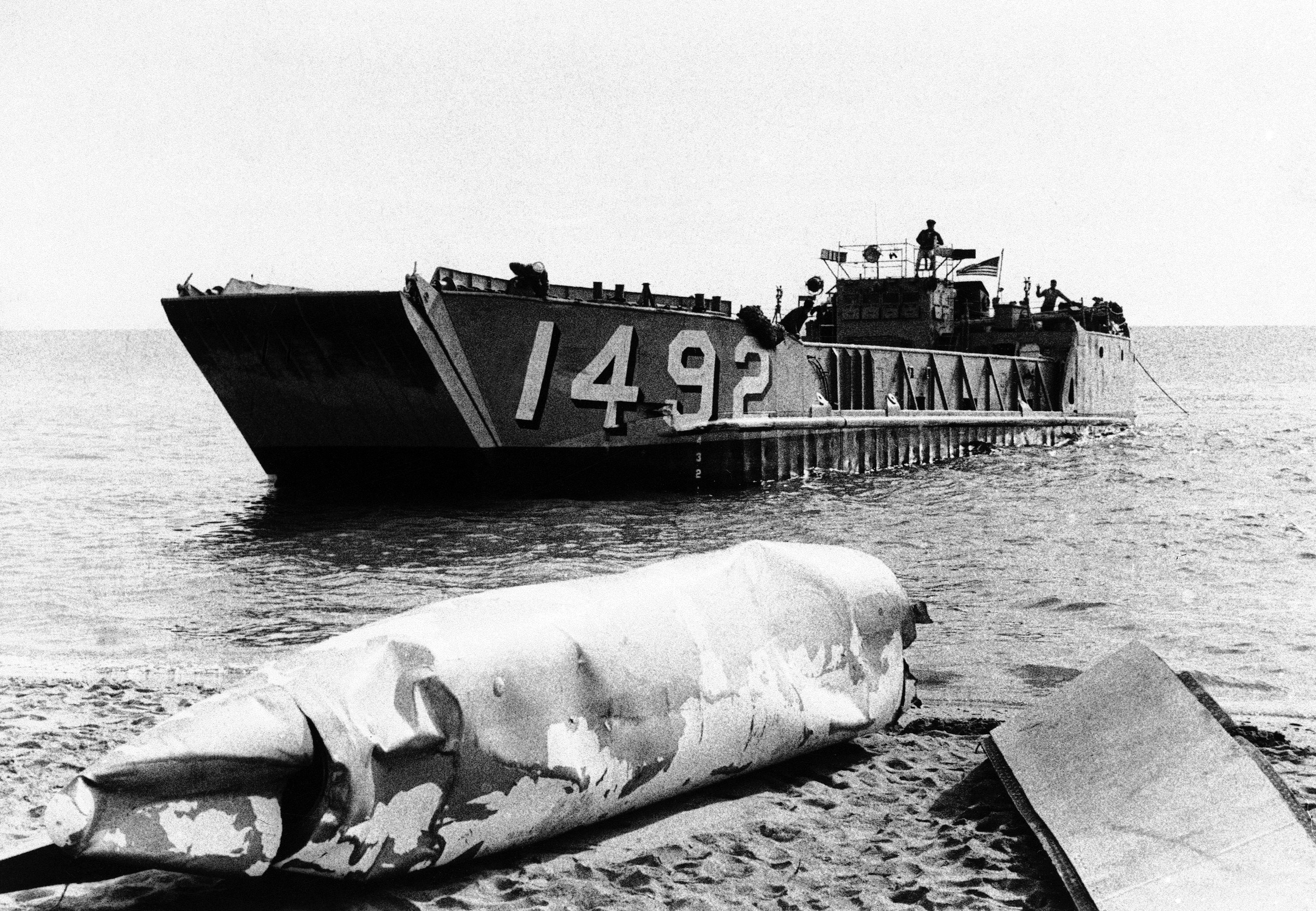 A U.S. landing craft heads back to sea after dropping a battered wing tank recovered from the Mediterranean Sea during a search for missing nuclear weapons after a B-52 crash in Palomares, Spain on Jan. 17, 1966. A new court ruling for the first time could reveal how many veterans faced health issues due to nuclear contamination in the years following the accident. (AP file photo)