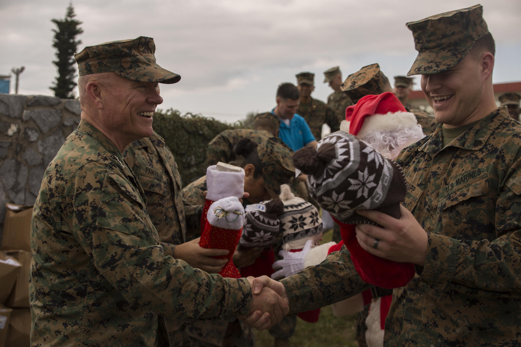Lt. Gen. Lawrence D. Nicholson, the commanding general of III Marine Expeditionary Force, hands out Christmas stockings to Marines at Camp Courtney, Okinawa, Japan, Dec. 22, 2017. (Cpl. Nelson Duenas/Marine Corps)