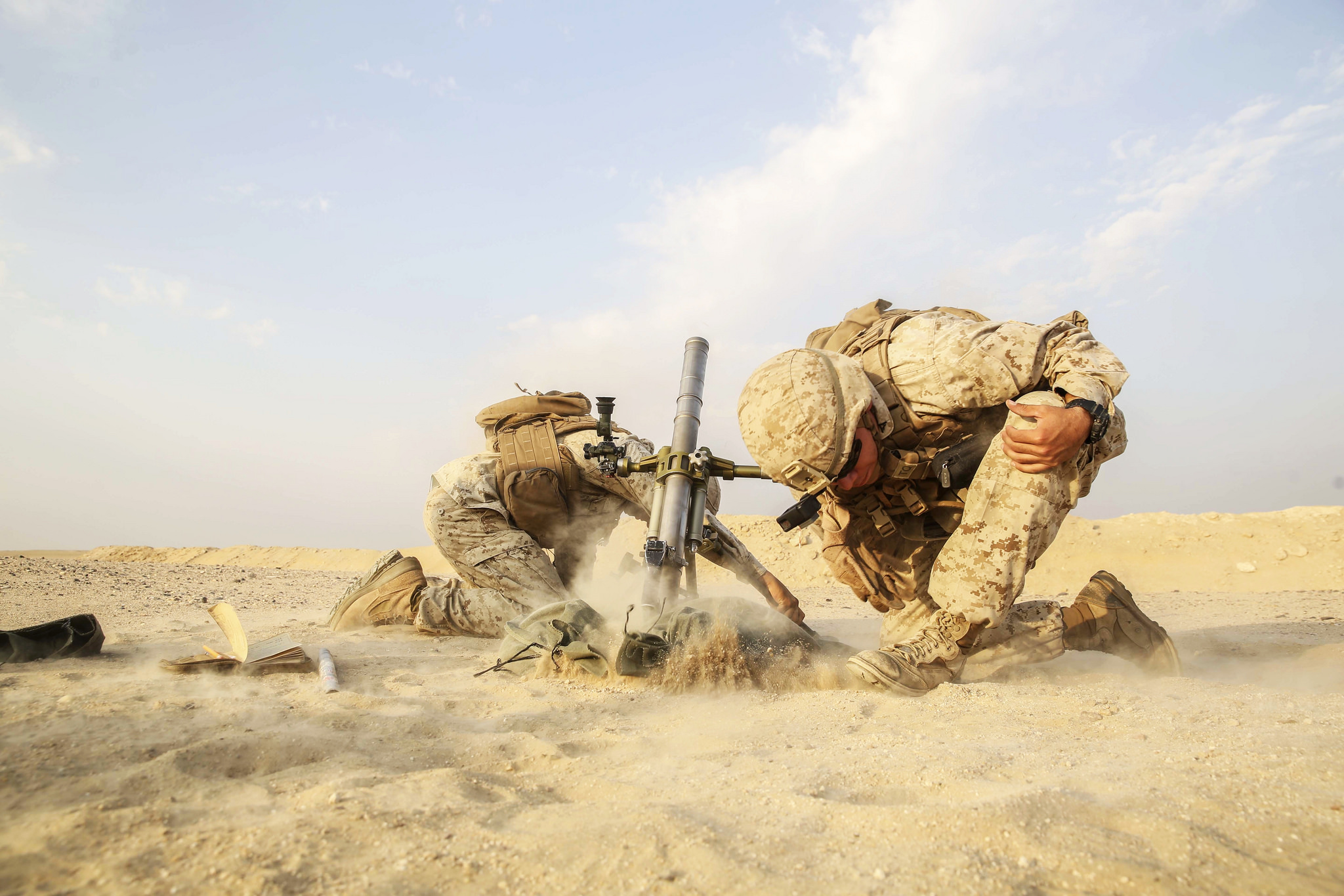Marines with Battalion Landing Team, 1st Battalion, 5th Marine Regiment, 15th Marine Expeditionary Unit fire a M224 60 mm mortar system. (Cpl. Timothy Valero/Marine Corps)