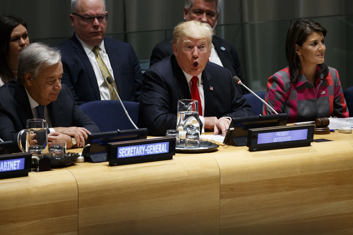 United Nations Secretary General Antonio Guterres, left, and U.S. Ambassador to the United Nations Nikki Haley, right, listen as President Donald Trump speaks during the
