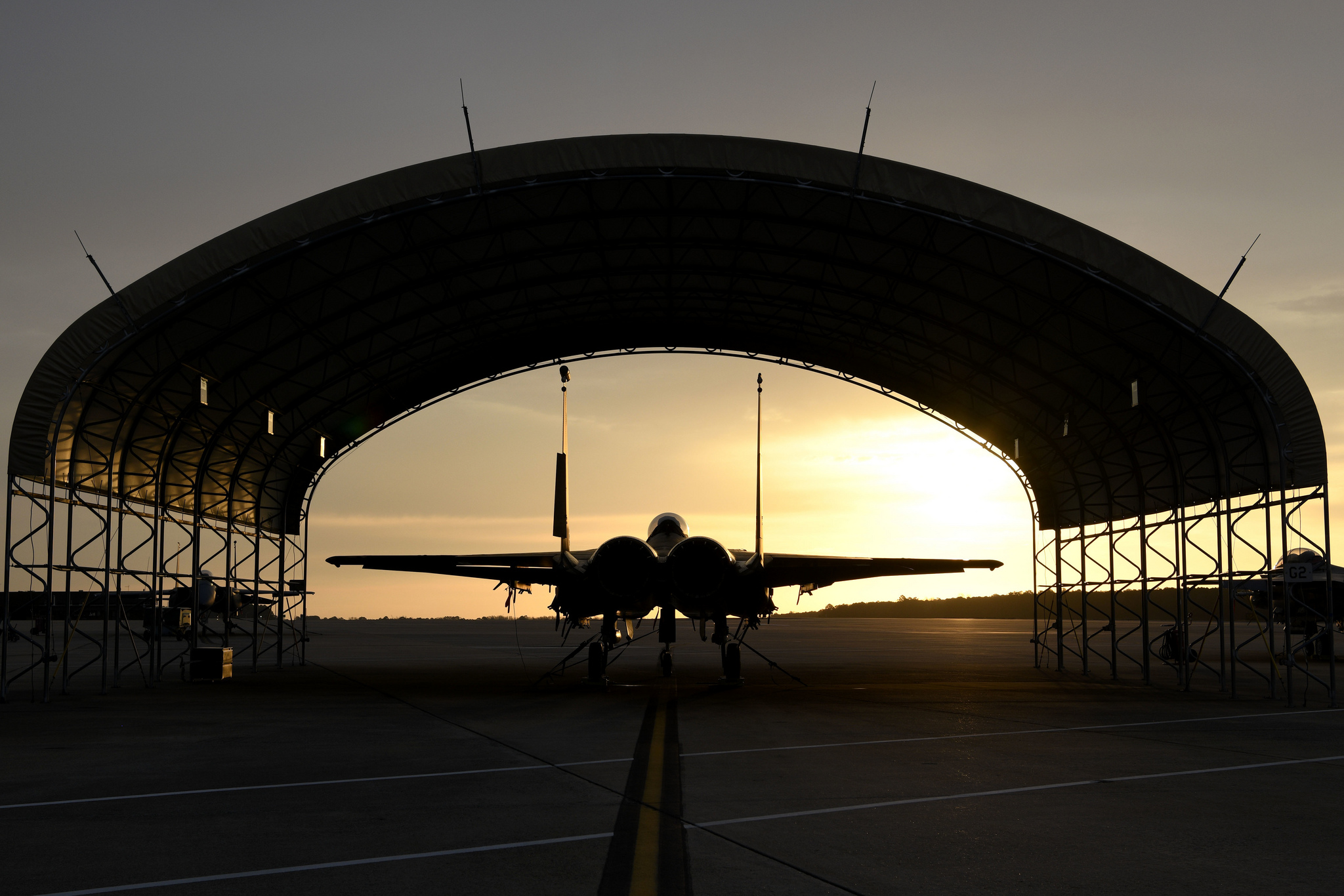 A U.S. Air Force F-15E Strike Eagle sits under a canopy on March 15, 2019, on the flightline at Seymour Johnson Air Force Base, N.C. (Senior Airman Victoria Boyton/Air Force)