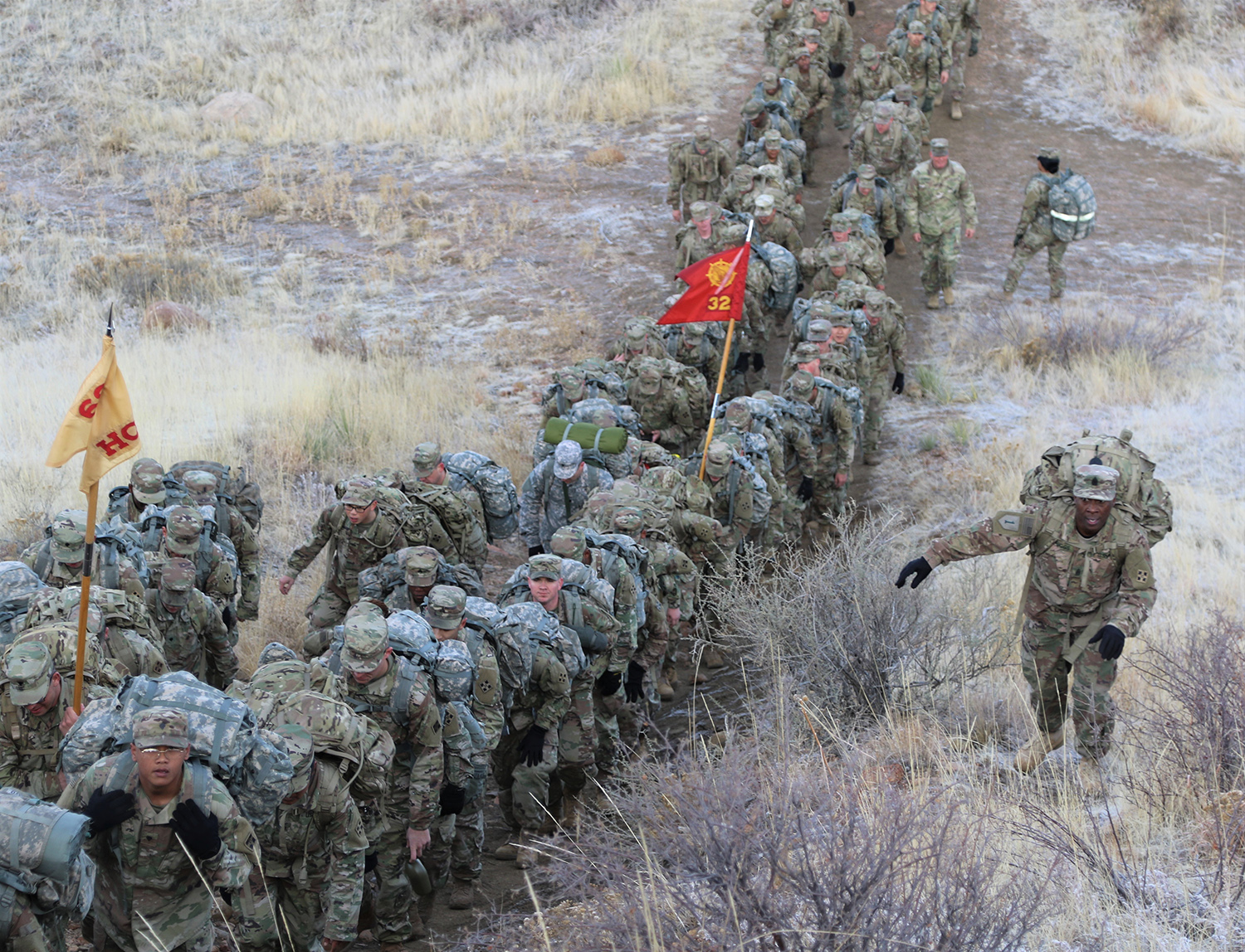 Soldiers with 68th Combat Sustainment Support Battalion, 4th Sustainment Brigade, move up a hill March 8 during a road march on Fort Carson, Colo. (Sgt. James Geelen/Army)