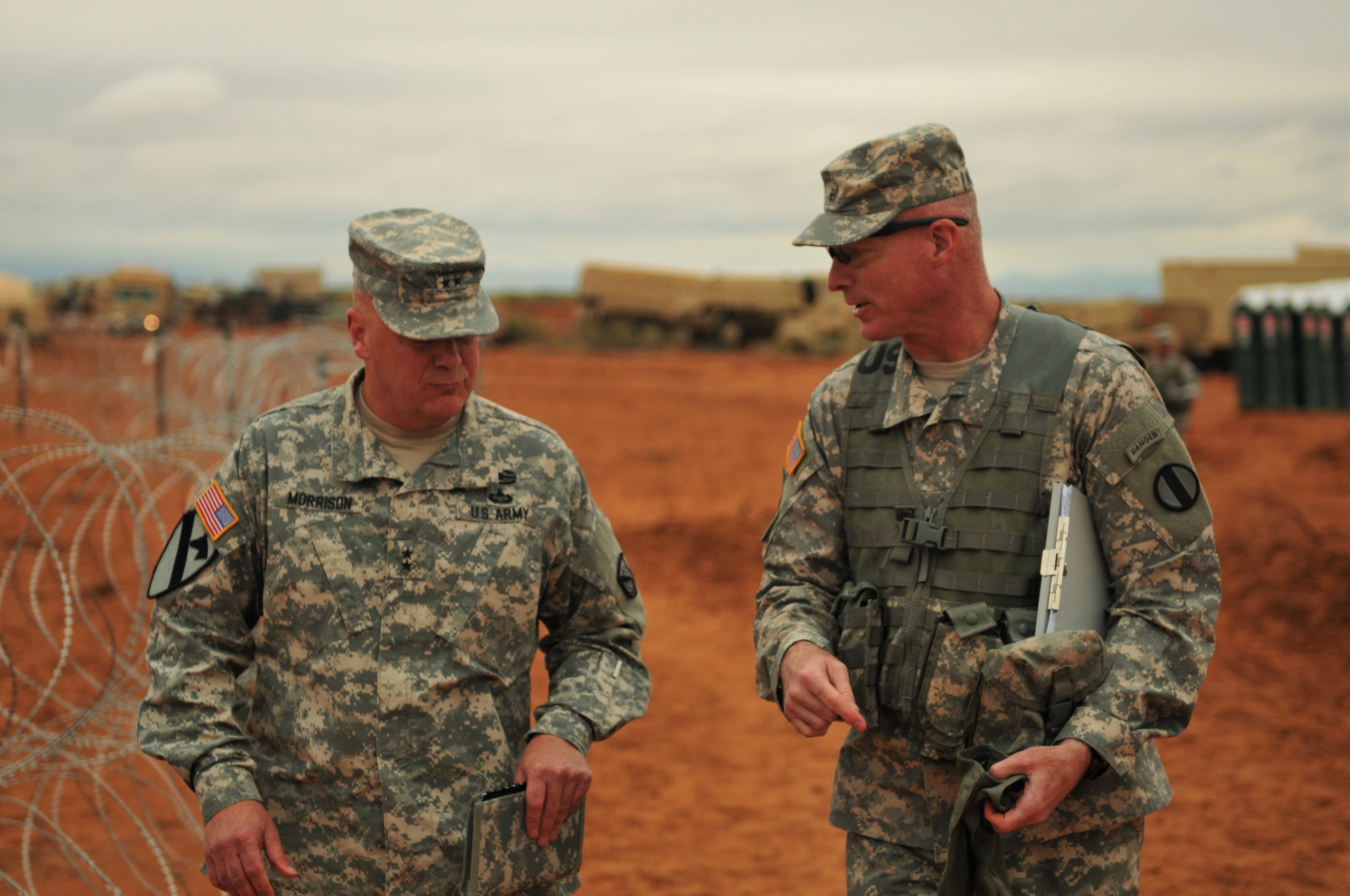 Maj. Gen. John Morrison (left), commanding general of Network Enterprise Technology Command, and Brig Gen. Terrence McKenrick, commanding general of Brigade Modernization Command (BMC), converse during a distinguished visitor's day at Fort Bliss, Texas, Oct. 5, 2015. BMC is the primary proponent for Network Integration Evaluation 16.1, which is focused on future force development, training readiness, and multinational interoperability with participants from 13 partner nations, more than 10,000 service members, and 3,000 civilians. (Capt. Ryan Jernegan, 24th Press Camp Headquarters/Army)